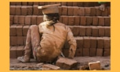 In South Asia, there are cases of whole families trapped in debt bondage in brick kilns. Here, a young girl works in a brick kiln.